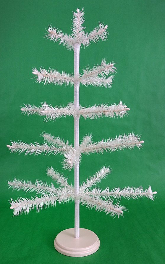 white feather tree on wood base 5 feather rows 3 between each row feather tree 24x16 tall wood base 4 rh15520