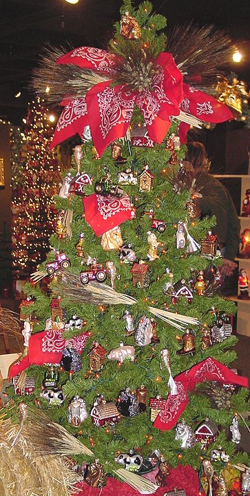 a large santa hat becomes the focal point for a santa tree - Santa Trees