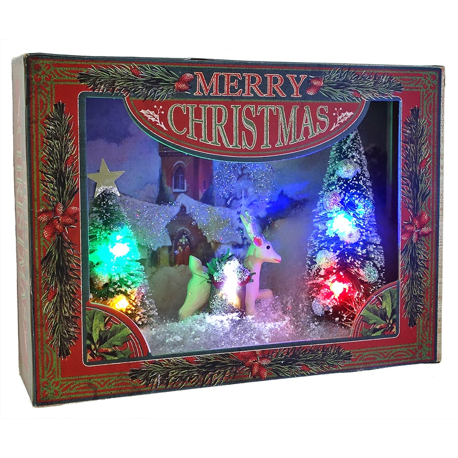 lighted diorama village scene with deer